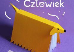 Na zdjęciu plakat projektu bibliotecznego Wyprawka Czytelnicza dla Przedszkolaka. Na plakacie grafika - książka modelowana na psa jamnika